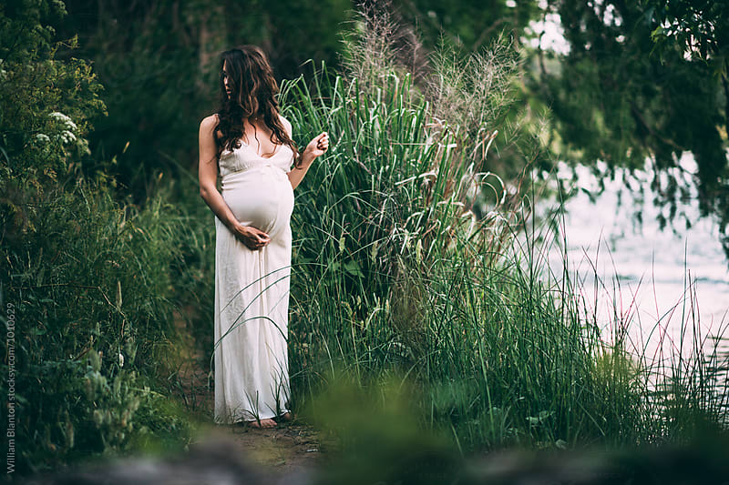 Pregnant Woman in the Woods by a River by William Blanton for Stocksy United