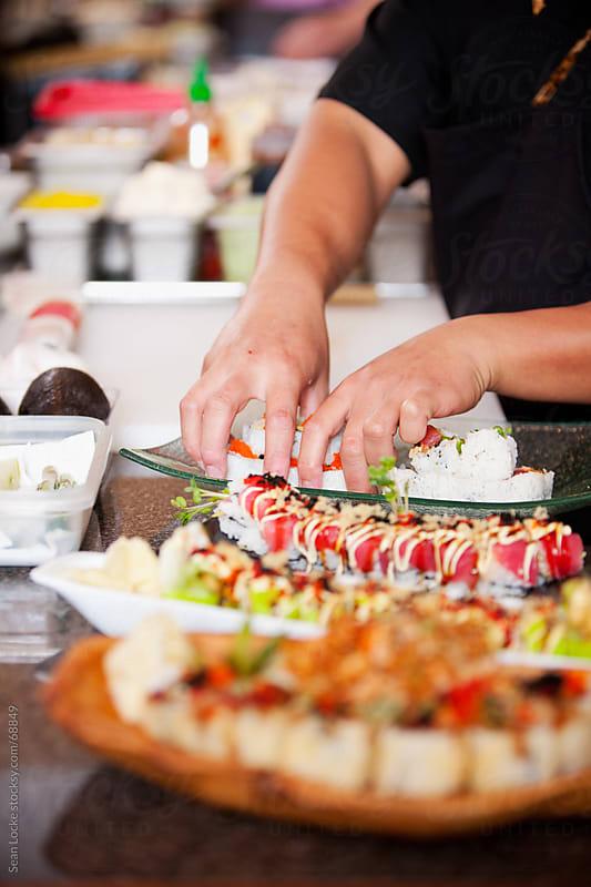 Sushi: Focus on Hands Preparing Sushi Rolls by Sean Locke for Stocksy United