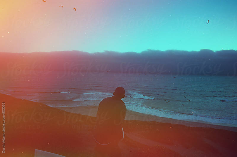 Sitting Near the Beach at Sunset  by Dustin Adams for Stocksy United