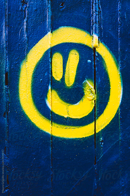 Smile painted on wall by Mauro Grigollo for Stocksy United