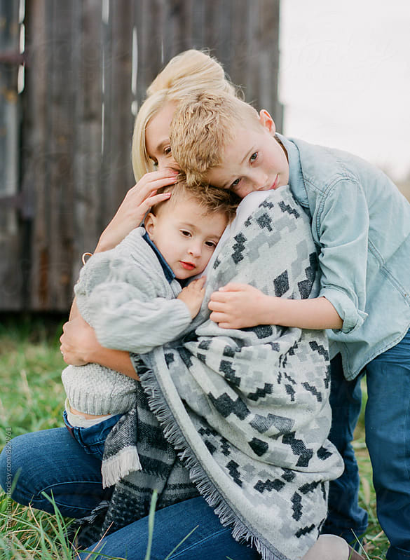 Mother and her sons by Marta Locklear for Stocksy United