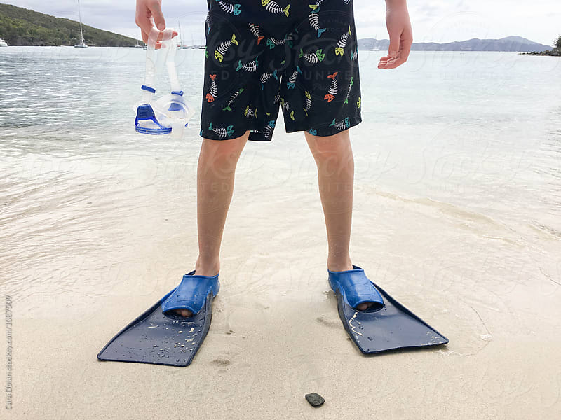 Boy is going snorkeling in St. John USVI by Cara Dolan for Stocksy United