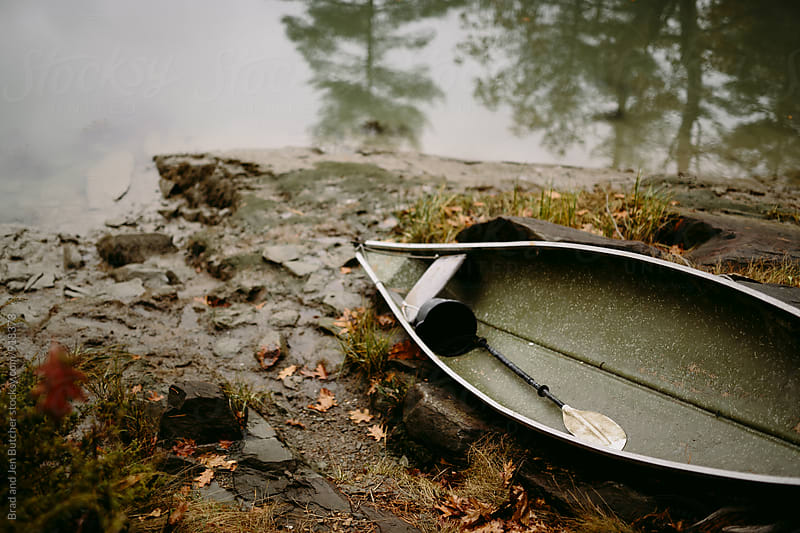 Row Boat On Rainy Day by Brad and Jen Butcher for Stocksy United