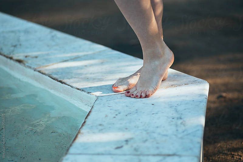 Woman feet near a basin by Vera Lair for Stocksy United