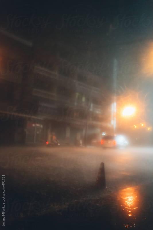 Street under heavy rain by Jovana Milanko for Stocksy United