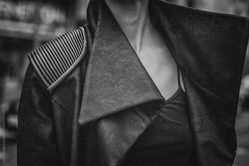 urban girl in a coat, detail by Igor Madjinca for Stocksy United