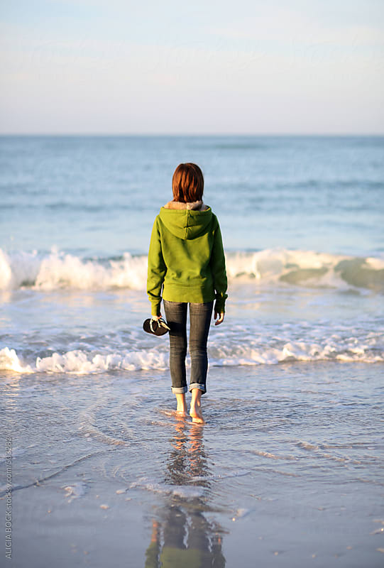 A Girl Standing At The Edge Of The Ocean On A Cool Morning by ALICIA BOCK for Stocksy United