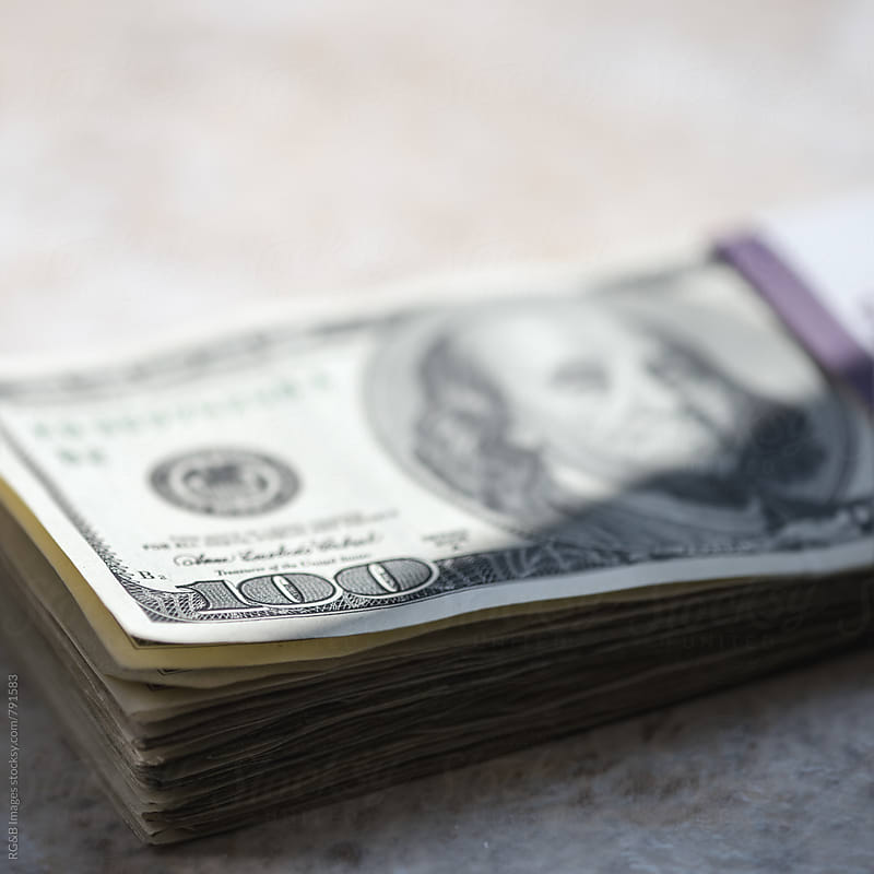 One hundred dollar bills stack by RG&B Images for Stocksy United