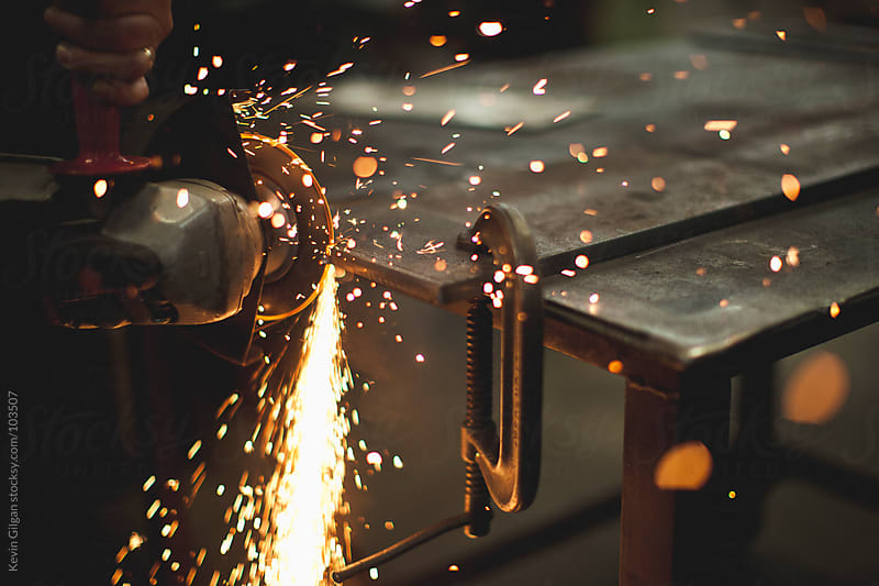 Grinding Metal by Kevin Gilgan for Stocksy United