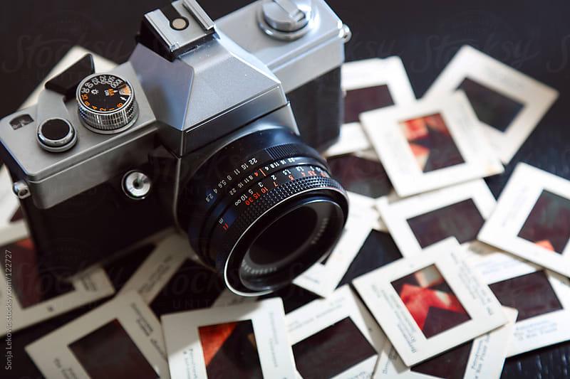 retro film camera and slides by Sonja Lekovic for Stocksy United
