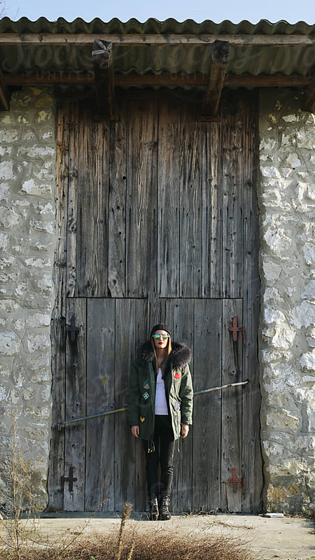 Young Modern Woman Standing in Front of Wooden Door by Mosuno for Stocksy United