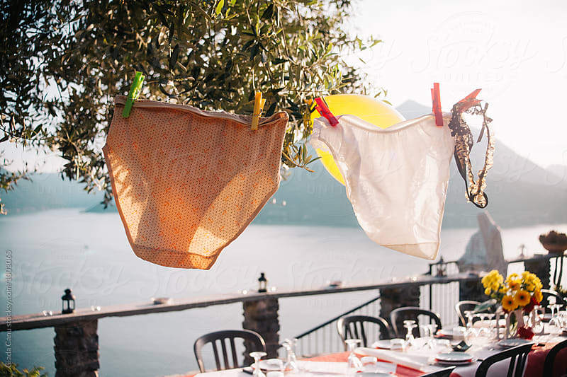 Underwears hanging over a table in a bachelorette party by Giada Canu for Stocksy United