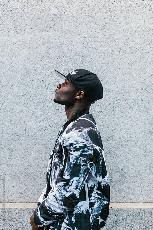 Young Black Man on an Urban Setting by VICTOR TORRES for Stocksy United
