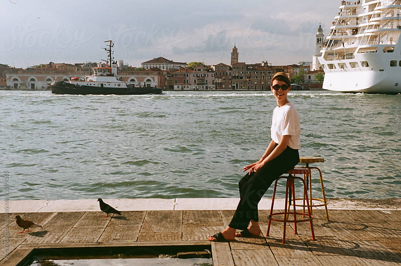 A portrait of a young beautiful woman in Venice by Anna Malgina for Stocksy United