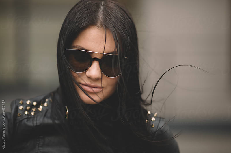 Closeup of young woman with sunglasses . by Alexey Kuzma for Stocksy United