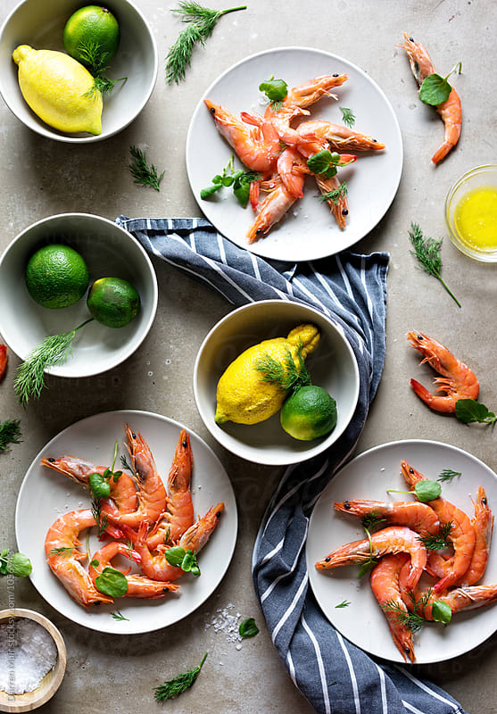 Shrimp with citrus and dill butter sauce. by Darren Muir for Stocksy United