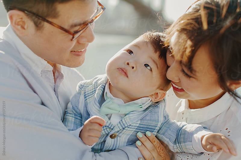 Close Up Portrait of Young Korean Family by Sidney Morgan for Stocksy United