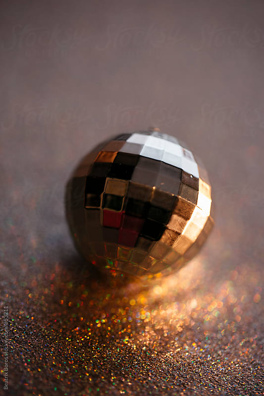 Disco ball with gittered background by Beatrix Boros for Stocksy United