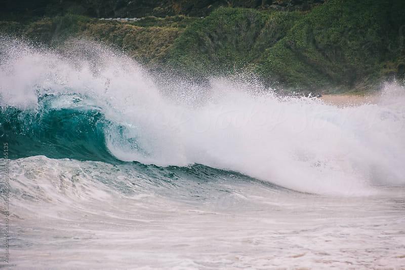 Wave breaking on beach in Hawaii by Alejandro Moreno de Carlos for Stocksy United