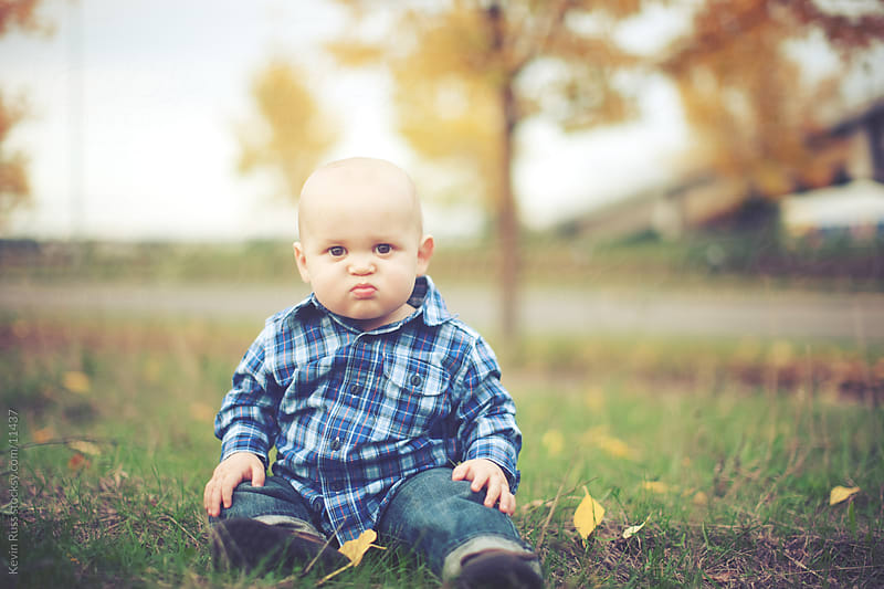 Fall Face Making Toddler by Kevin Russ for Stocksy United
