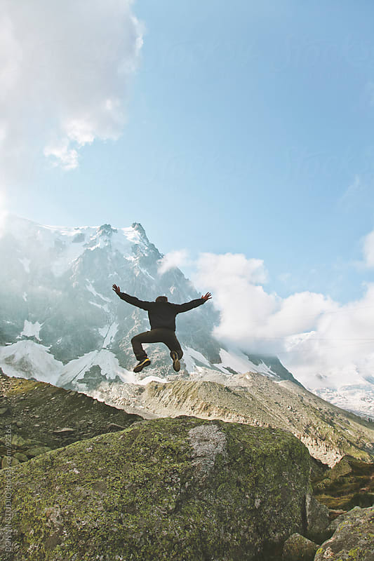 Man jumping on mountain landscape. France. by BONNINSTUDIO for Stocksy United