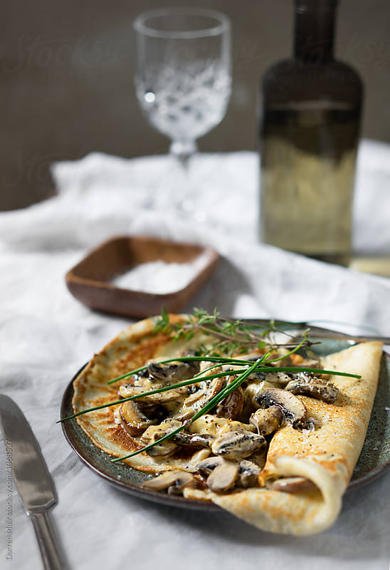 Mushroom breakfast crepes.  by Darren Muir for Stocksy United