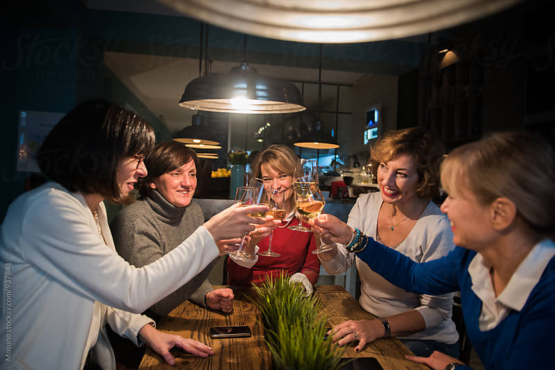 Senior Female Friends Toasting with Wine by Mosuno for Stocksy United