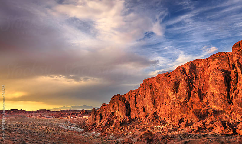 Red rock and clouds by ALAN SHAPIRO for Stocksy United