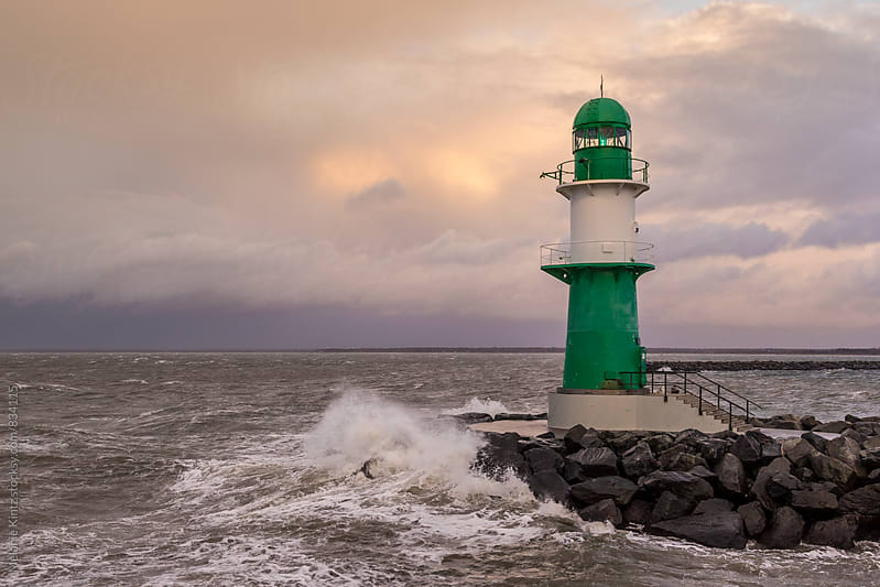 Germany, Warnemuende - Green lighthouse on a stormy day by Melanie Kintz for Stocksy United