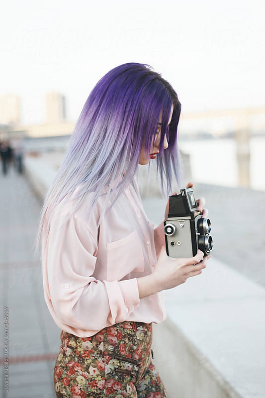 Young girl taking a photo with an old camera by Jovana Rikalo for Stocksy United