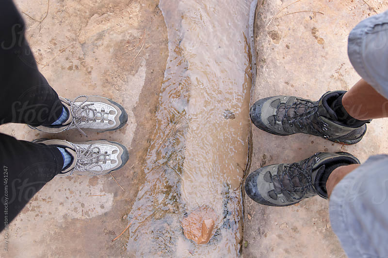 View of a couples hiking boots from above by Amy Covington for Stocksy United