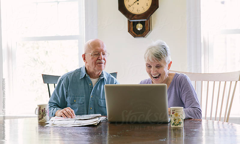 Senior Couple Working on Laptop by Raymond Forbes LLC for Stocksy United