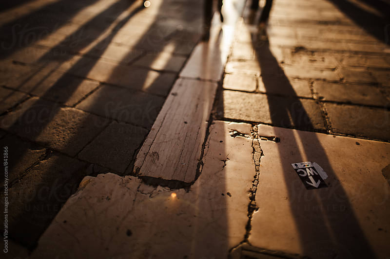 Shadow on the street at sunset by Good Vibrations Images for Stocksy United