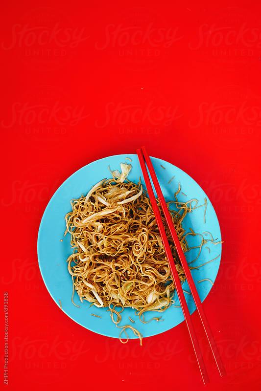 Street food - noodles by Artem Zhushman for Stocksy United
