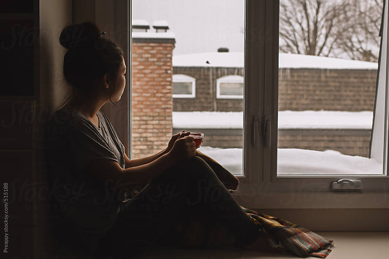 Looking out window. by Preappy for Stocksy United