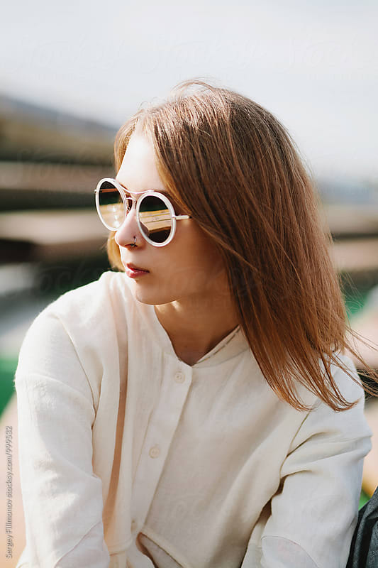 Portrait of a caucasian beauty girl in sunglasses by Sergey Filimonov for Stocksy United