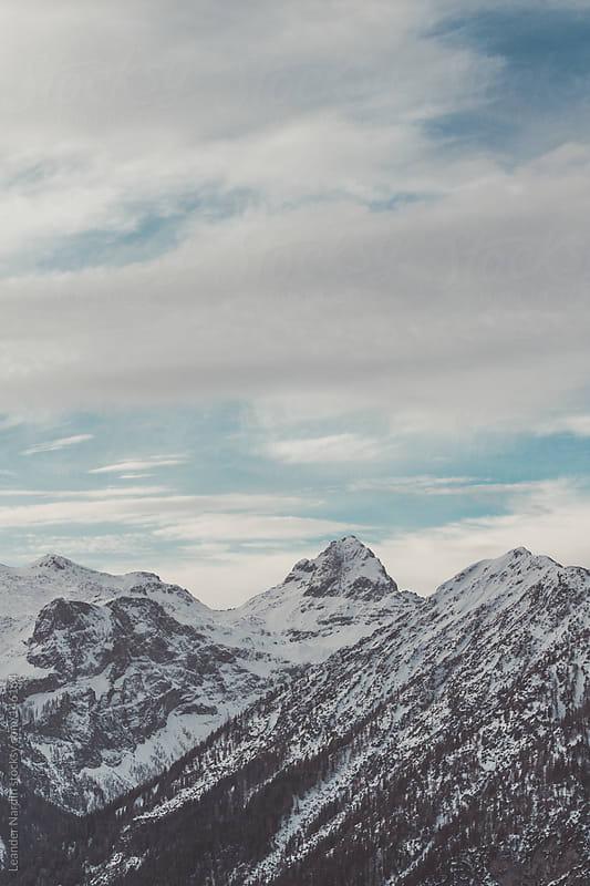 Snowcovered mountain peak  by Leander Nardin for Stocksy United