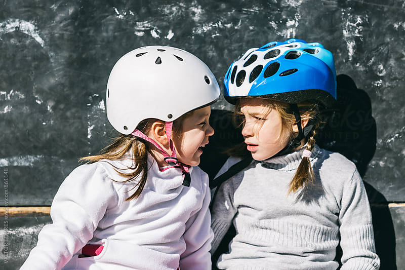Two Sisters Having a Break During a Rollerblading Exercise by Victor Torres for Stocksy United