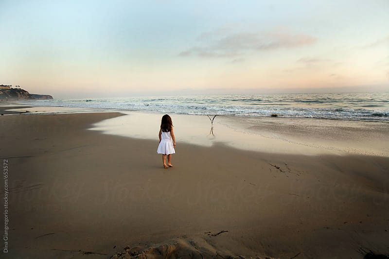 Girl Walking Towards Ocean And Birds by Dina Giangregorio for Stocksy United