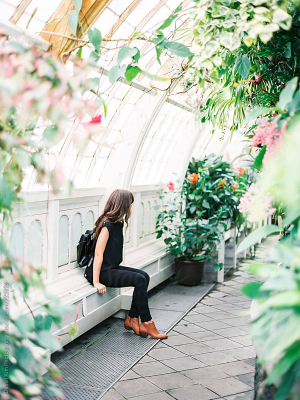 Female sitting in arboretum  by Daniel Kim Photography for Stocksy United