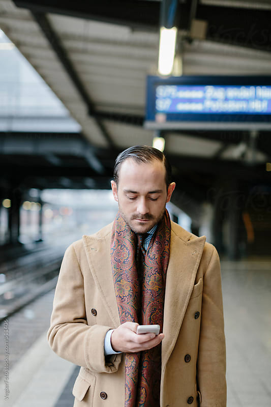 Businessman Checking Smart Phone  by VegterFoto for Stocksy United