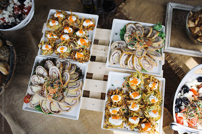 Delicious appetizers plates from overhead by Adrian Cotiga for Stocksy United