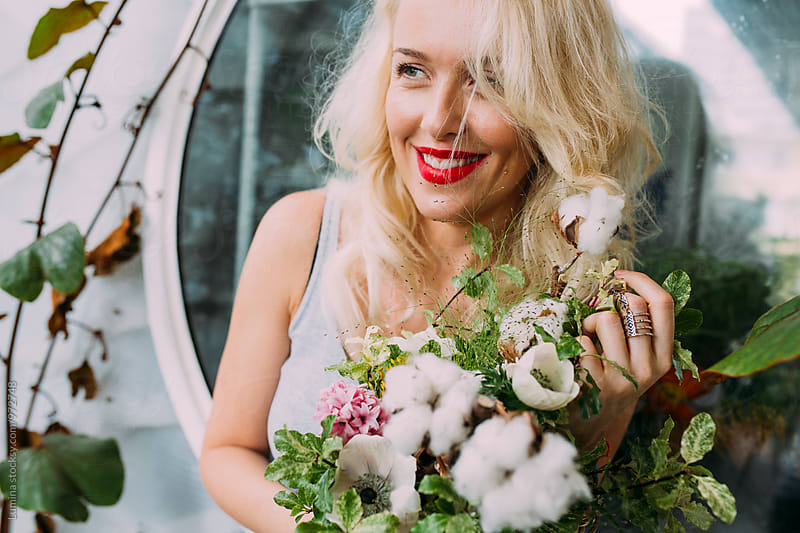 Happy Woman Holding Flower Bouquet by Lumina for Stocksy United