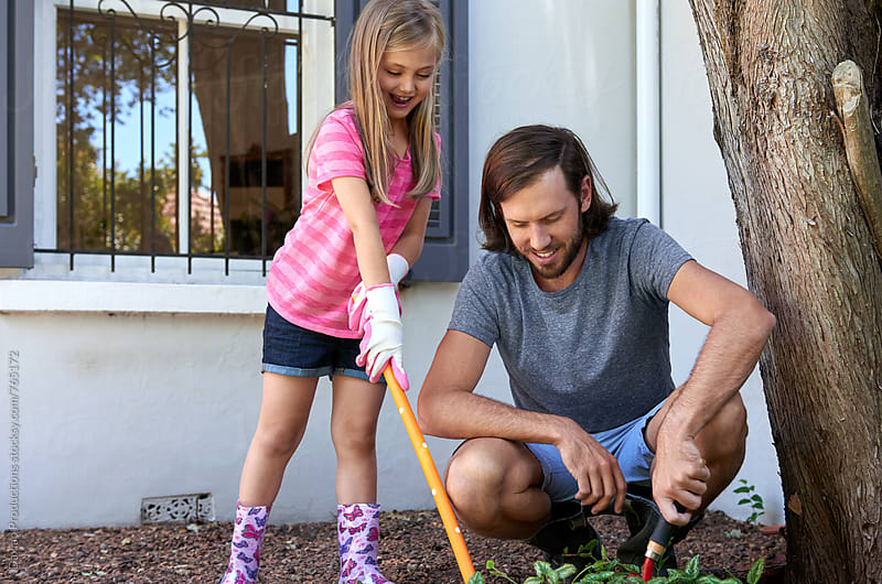 father and daughter gardening by Daxiao Productions for Stocksy United