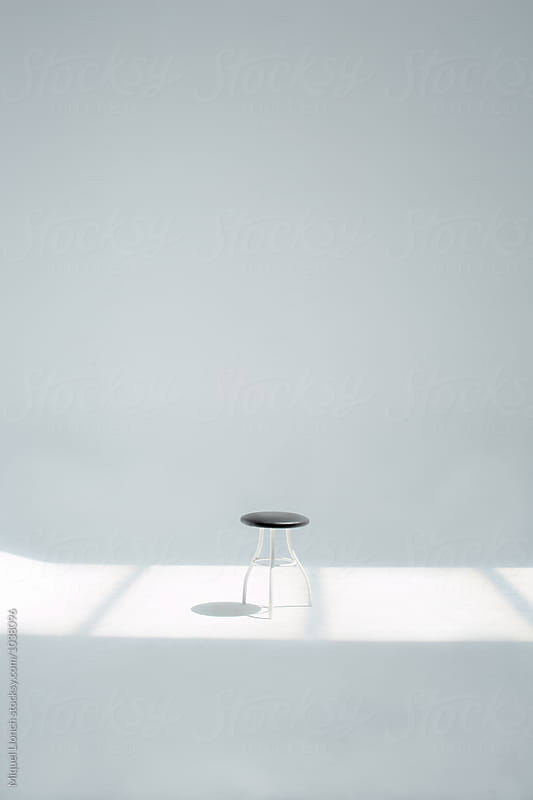 Small stool in the studio by Miquel Llonch for Stocksy United