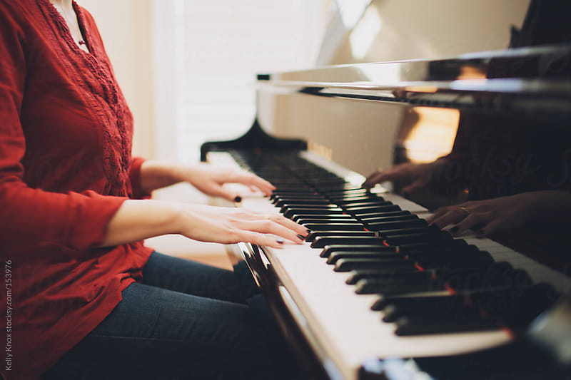 woman playing the piano by Kelly Knox for Stocksy United