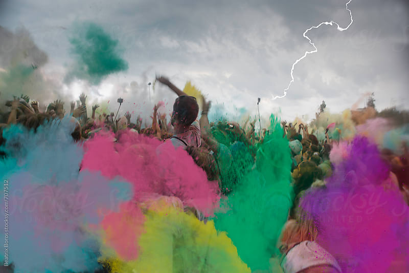 Storm and thunder at an outdoor event celebrated with holi powder by Beatrix Boros for Stocksy United