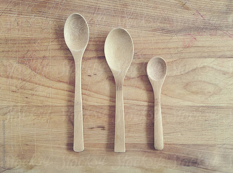 Wooden spoons on a wooden board by Greg Schmigel for Stocksy United