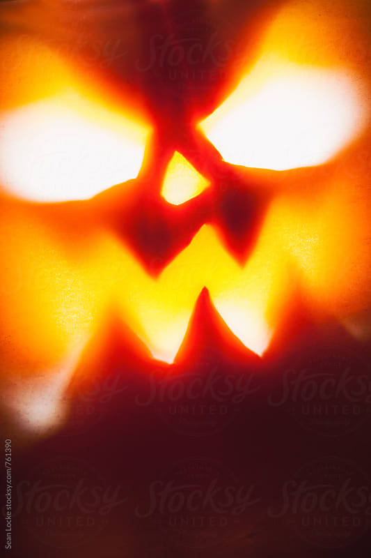 Halloween: Scary Jack-O-Lantern Face Glows With Evil by Sean Locke for Stocksy United