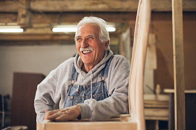 Smiling Carpenter at His Workshop by Lumina for Stocksy United